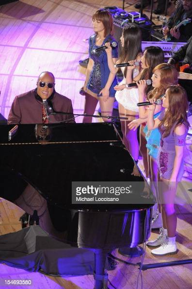 Messenger of Peace Stevie Wonder and singers The Wonder Girls perform during the United Nations Day Concert at United Nations on October 24 2012 in...