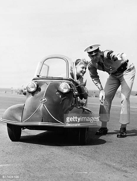 Messerschmidt's Mighty Midget When you've lost your way it's a comfort to have a sixfoot air policeman to direct you Guiding Miss Fritsche in her...