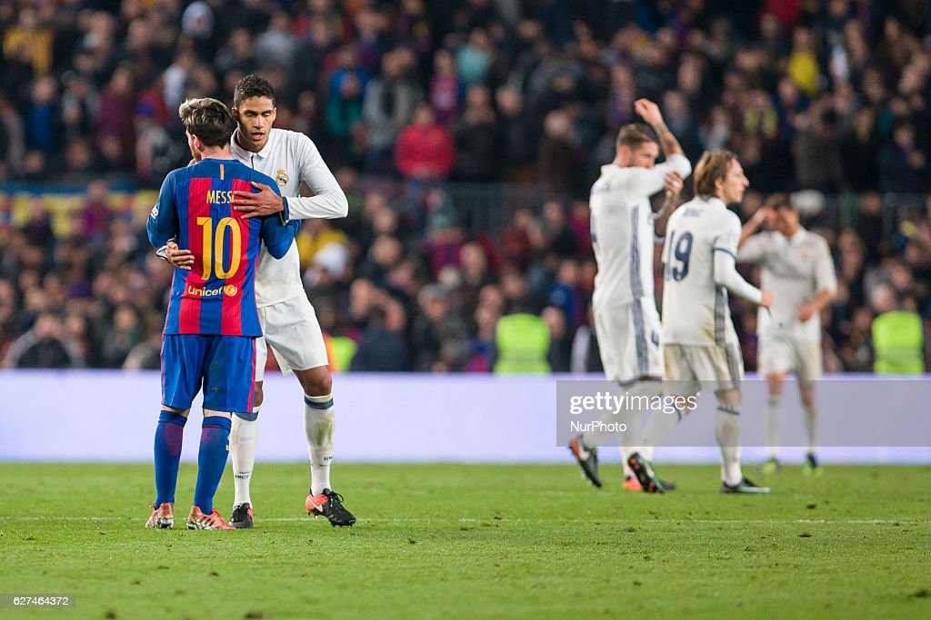 Messi greets Raphael Varane at the end of the match between FC Barcelona vs Real Madrid for the round 14 of the Liga Santander played at Camp Nou...