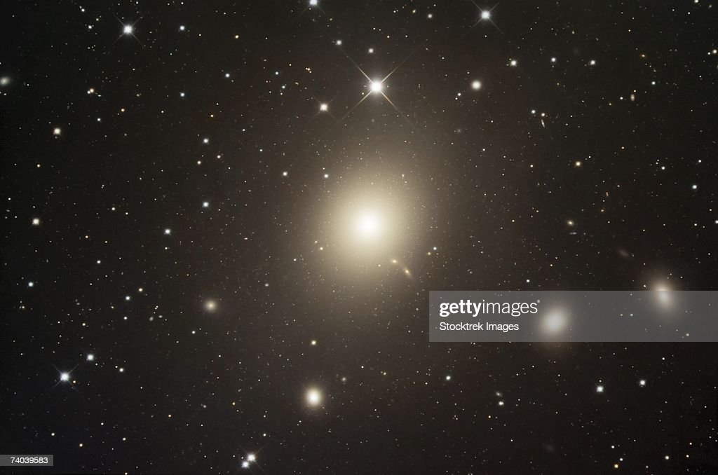 Messier 87, also known as Virgo A or NGC 4486, is a giant elliptical galaxy. The galaxy is the largest and brightest galaxy within the northern Virgo Cluster.