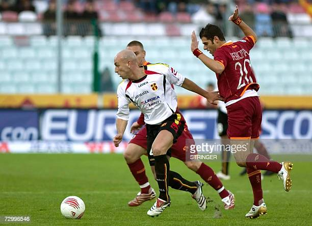Messina's midfielder Manolo Pestrin fights for the ball with Roma midfielder Simone Perrotta during their Serie A football match in Messina 14...