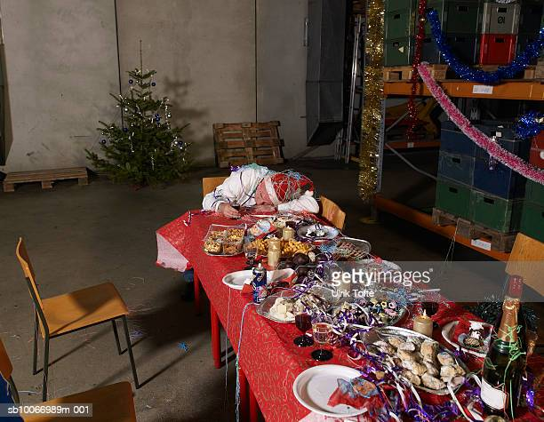Messy christmas table in warehouse, elevated view