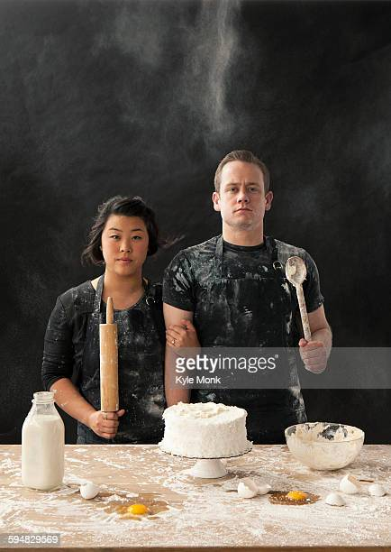 Messy couple baking cake
