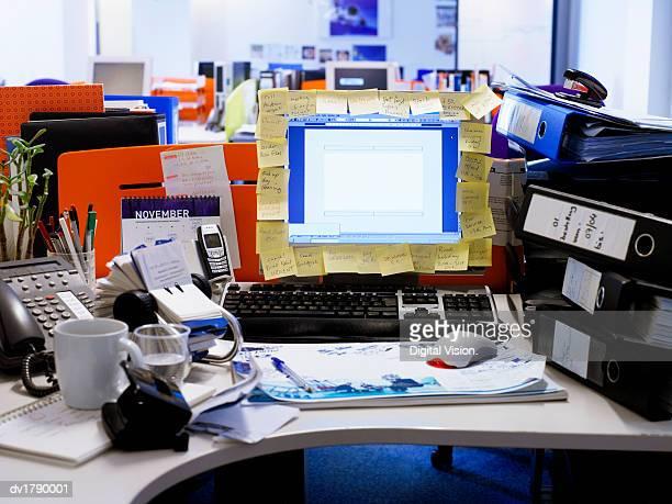 Messy Desk in an Open Plan Office