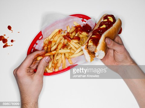 Messy eating, hot dog and fries, overhead view