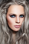 Close-up portrait of young beautiful woman with long grey hair and stylish smoky eyes make-up