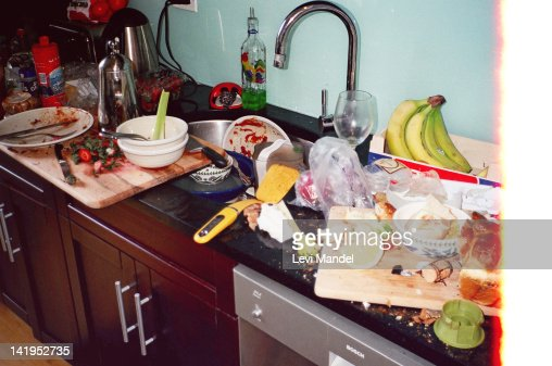 Messy kitchen after huge dinner party : Stock Photo