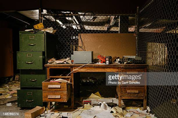 Messy office with desk and file cabinet