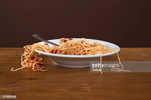 A messy plate of spaghetti, studio shot