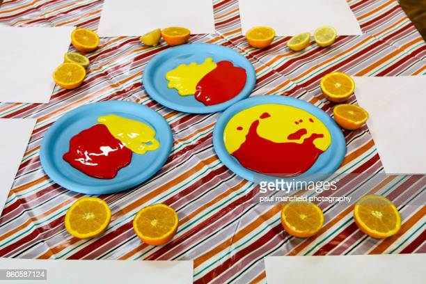 Messy play with paint and fruit at playgroup