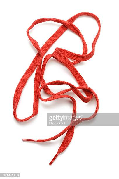 Messy red shoelace isolated on white