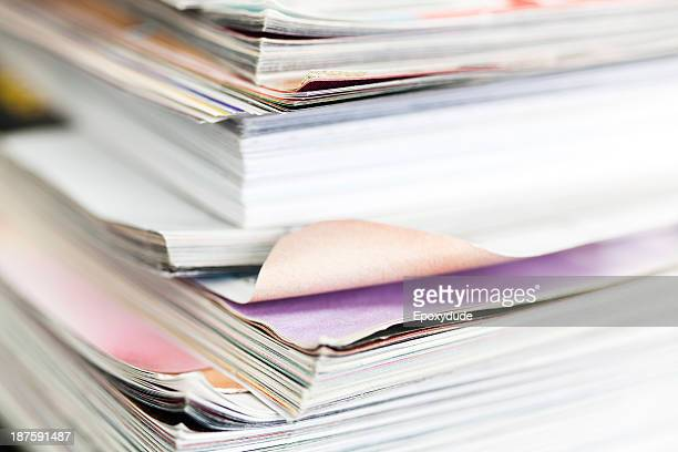 A messy stack of well thumbed through magazines