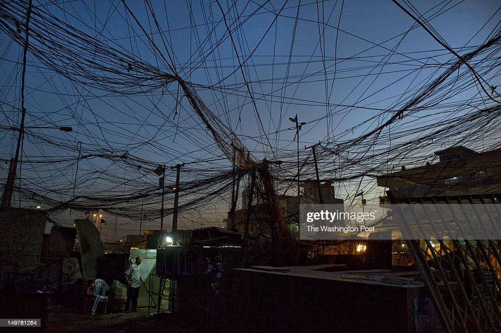 A messy web of electrical wires runs from two privately-owned generators to nearby businesses and residences in the Sadr City section of Baghdad on Sunday, July 15, 2012, in Baghdad, Iraq. Oil production and revenues are at levels not seen since before former president Saddam Hussein invaded Kuwait in 1990. Yet the government barely provides the basics of lifeÑclean water and electricity on summer days that routinely crack 120 degrees. Prime Minister Nouri al-Maliki, IraqÕs democratically elected leader, presides over a government that, according to critics from international human rights groups to Baghdad bus drivers, is ineffective and increasingly authoritarian and brutal to its political enemies. Corruption is rampant, and people complain that bribery is the only way to get a job, a building permit or a government contract. Transparency International listed Iraq as the 175th worst out of 183 countries in its 2011 annual corruption survey.