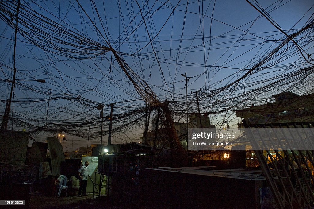 A messy web of electrical wires runs from two privately-owned generators to nearby businesses and residences in the Sadr City section of Baghdad on Sunday, July 15, 2012, in Baghdad, Iraq. Oil production and revenues are at levels not seen since before former president Saddam Hussein invaded Kuwait in 1990. Yet the government barely provides the basics of life—clean water and electricity on summer days that routinely crack 120 degrees. Prime Minister Nouri al-Maliki, Iraq's democratically elected leader, presides over a government that, according to critics from international human rights groups to Baghdad bus drivers, is ineffective and increasingly authoritarian and brutal to its political enemies. Corruption is rampant, and people complain that bribery is the only way to get a job, a building permit or a government contract. Transparency International listed Iraq as the 175th worst out of 183 countries in its 2011 annual corruption survey.