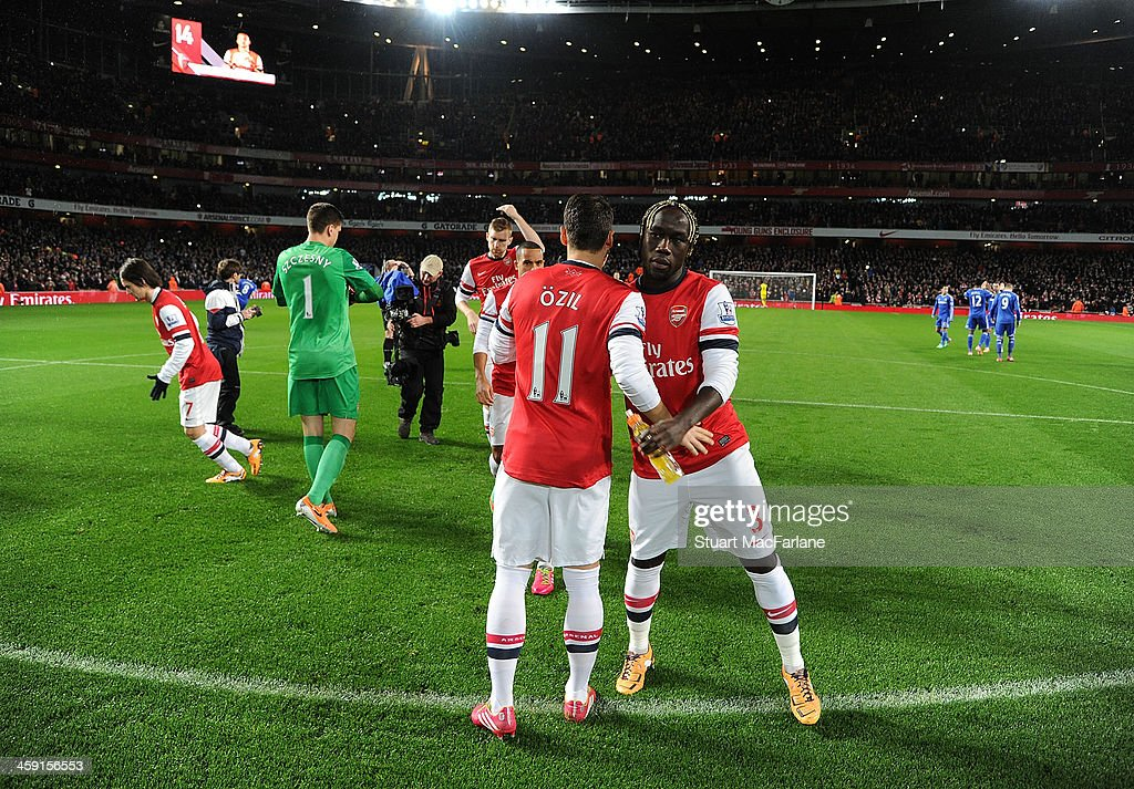 Mesut Oezil and Bacary Sagna of Arsenal before the Barclays Premier League match between Arsenal and Chelsea at Emirates Stadium on December 23, 2013 in London, England.