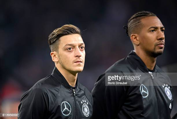 Mesut Oezil and Jerome Boateng of Germany sing the national anthem prior to the FIFA World Cup 2018 qualifying match between Germany and Czech...
