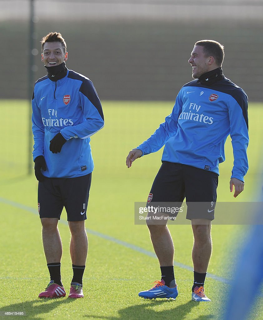 Mesut Oezil and Lukas Podolski of Arsenal during a training session at London Colney on January 27, 2014 in St Albans, England.