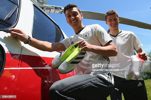 Mesut Oezil and Manuel Neuer with their new Adidas football boots from the new Mercury Pack which were hand delivered by a skydive team on May 25...