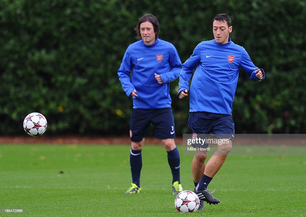 Mesut Oezil (R) and Tomas Rosicky of Arsenal in action during an Arsenal training session ahead of the UEFA Champions League Group F match against Borussia Dortmund at London Colney on October 21, 2013 in St Albans, England.