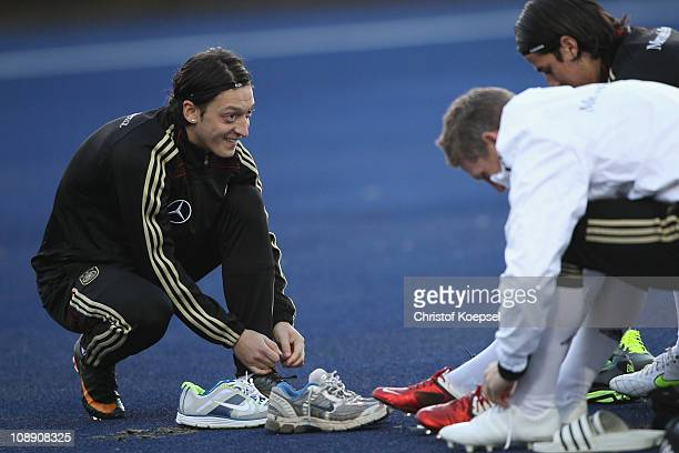 Mesut Oezil binds his shoes during the DFB training session at the training ground of the Sporting school Kaiserau on February 8 2011 in Kamen...