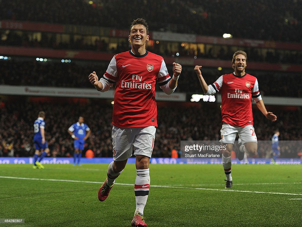 <a gi-track='captionPersonalityLinkClicked' href=/galleries/search?phrase=Mesut+Oezil&family=editorial&specificpeople=764075 ng-click='$event.stopPropagation()'>Mesut Oezil</a> celebrates scoring for Arsenal during the match at Emirates Stadium on December 8, 2013 in London, England.