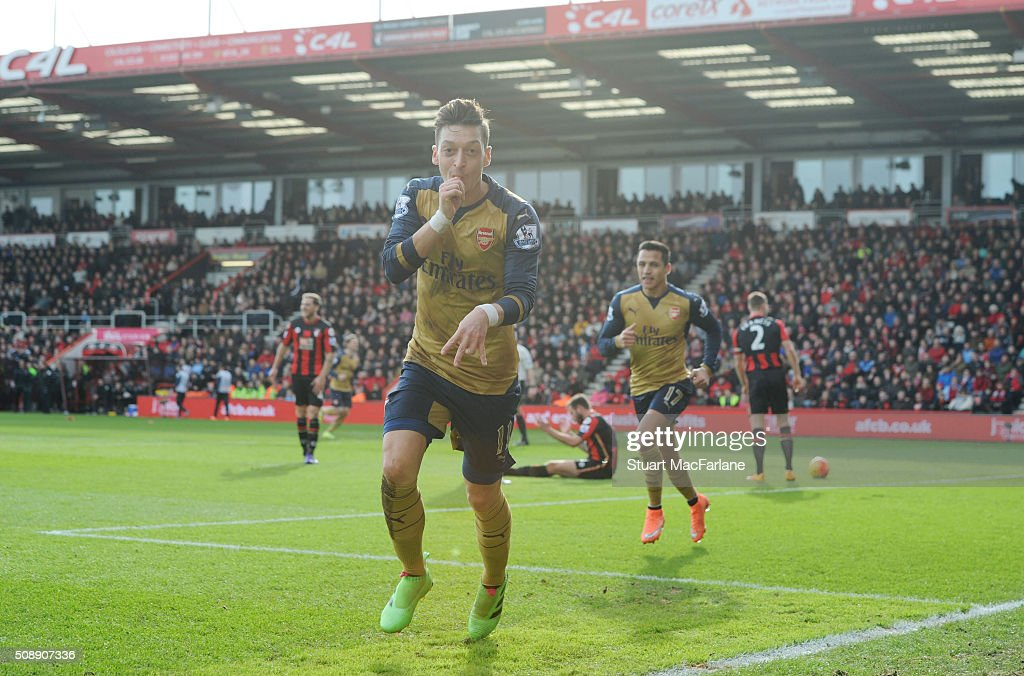 <a gi-track='captionPersonalityLinkClicked' href=/galleries/search?phrase=Mesut+Oezil&family=editorial&specificpeople=764075 ng-click='$event.stopPropagation()'>Mesut Oezil</a> celebrates scoring the first Arsenal goal during the Barclays Premier League match between AFC Bournemouth and Arsenal at The Vitality Stadium on February 7, 2016 in Bournemouth, England.