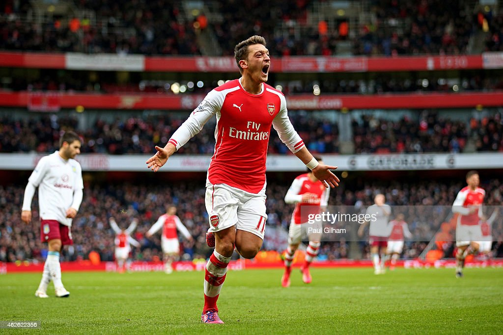 Mesut Oezil of Arsenal celebrates after scoring his team's second goal during the Barclays Premier League match between Arsenal and Aston Villa at the Emirates Stadium on February 1, 2015 in London, England.