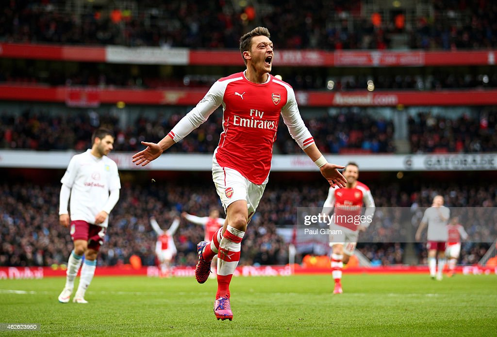 <a gi-track='captionPersonalityLinkClicked' href=/galleries/search?phrase=Mesut+Oezil&family=editorial&specificpeople=764075 ng-click='$event.stopPropagation()'>Mesut Oezil</a> of Arsenal celebrates after scoring his team's second goal during the Barclays Premier League match between Arsenal and Aston Villa at the Emirates Stadium on February 1, 2015 in London, England.