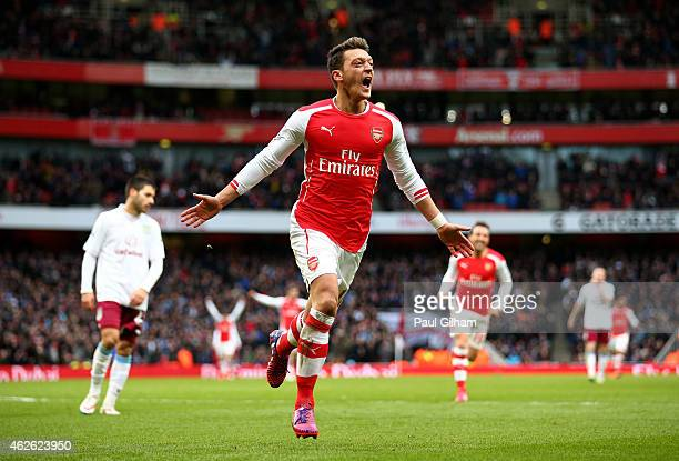 Mesut Oezil of Arsenal celebrates after scoring his team's second goal during the Barclays Premier League match between Arsenal and Aston Villa at...