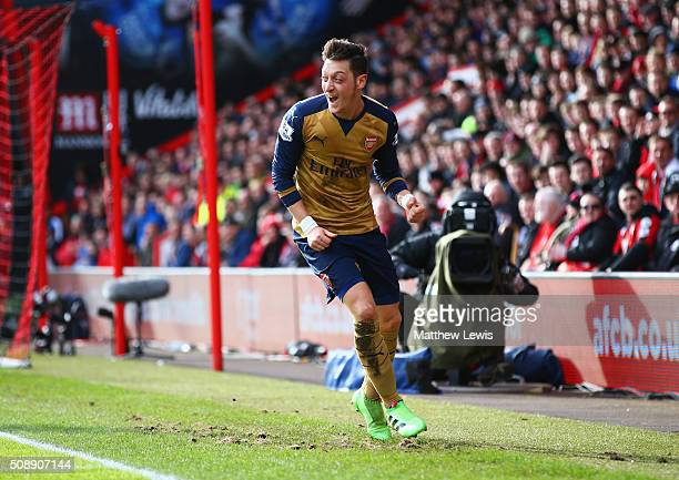 Mesut Oezil of Arsenal celebrates as he scores their first goal during the Barclays Premier League match between AFC Bournemouth and Arsenal at the...