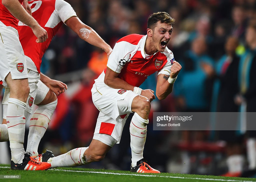 <a gi-track='captionPersonalityLinkClicked' href=/galleries/search?phrase=Mesut+Oezil&family=editorial&specificpeople=764075 ng-click='$event.stopPropagation()'>Mesut Oezil</a> of Arsenal celebrates as he scores their second goal during the UEFA Champions League Group F match between Arsenal FC and FC Bayern Munchen at Emirates Stadium on October 20, 2015 in London, United Kingdom.