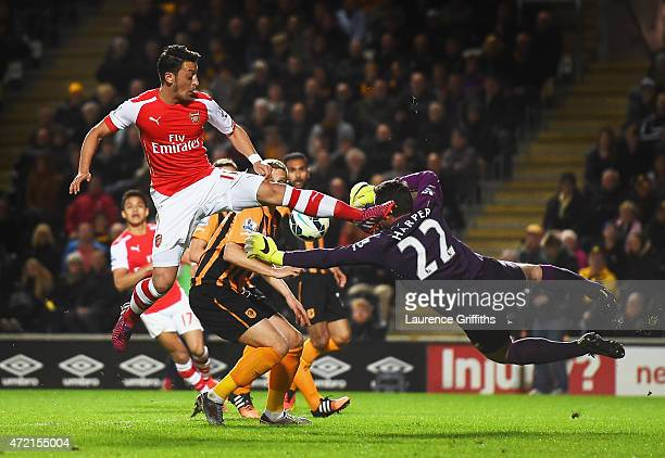 Mesut Oezil of Arsenal challenges goalkeeper Steve Harper of Hull City during the Barclays Premier League match between Hull City and Arsenal at KC...
