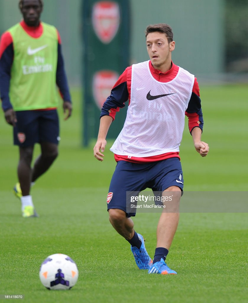 <a gi-track='captionPersonalityLinkClicked' href=/galleries/search?phrase=Mesut+Oezil&family=editorial&specificpeople=764075 ng-click='$event.stopPropagation()'>Mesut Oezil</a> of Arsenal during a training session at London Colney on September 21, 2013 in St Albans, England.