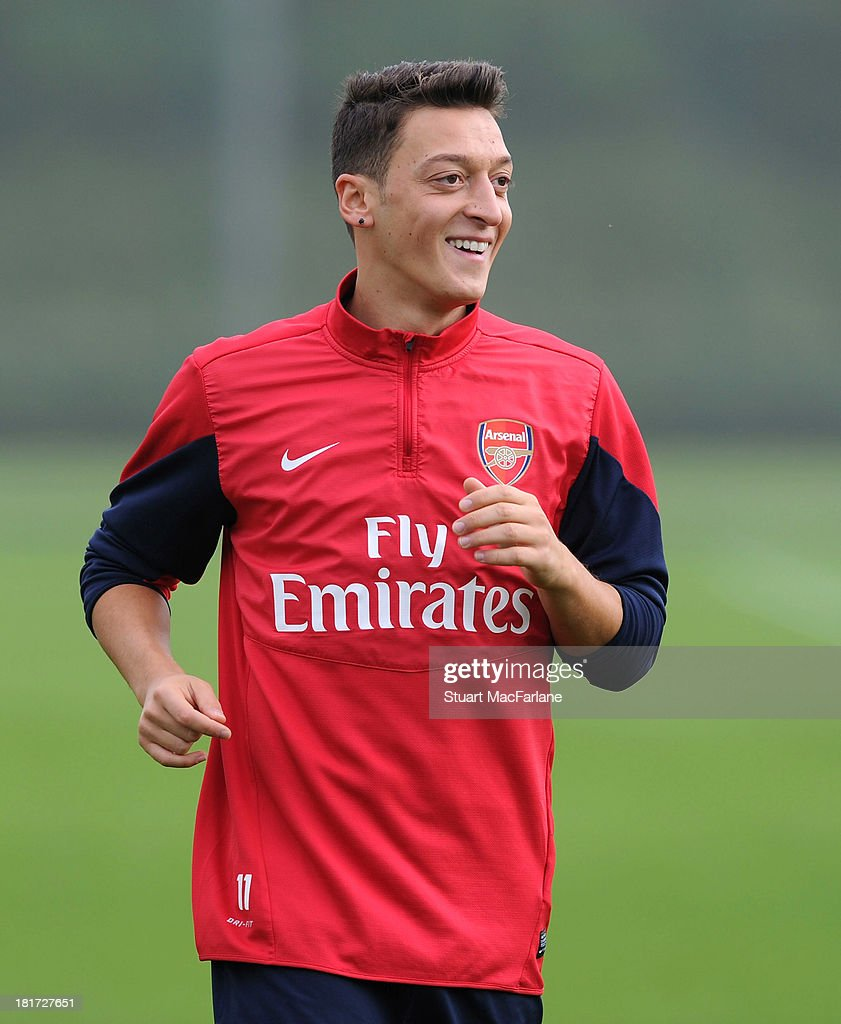 <a gi-track='captionPersonalityLinkClicked' href=/galleries/search?phrase=Mesut+Oezil&family=editorial&specificpeople=764075 ng-click='$event.stopPropagation()'>Mesut Oezil</a> of Arsenal during a training session at London Colney on September 24, 2013 in St Albans, England.