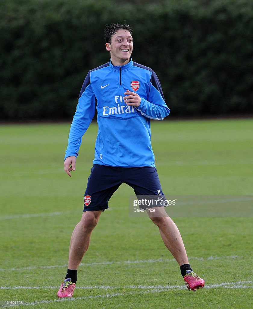 <a gi-track='captionPersonalityLinkClicked' href=/galleries/search?phrase=Mesut+Oezil&family=editorial&specificpeople=764075 ng-click='$event.stopPropagation()'>Mesut Oezil</a> of Arsenal during Arsenal Training Session at London Colney on January 23, 2014 in St Albans, England.