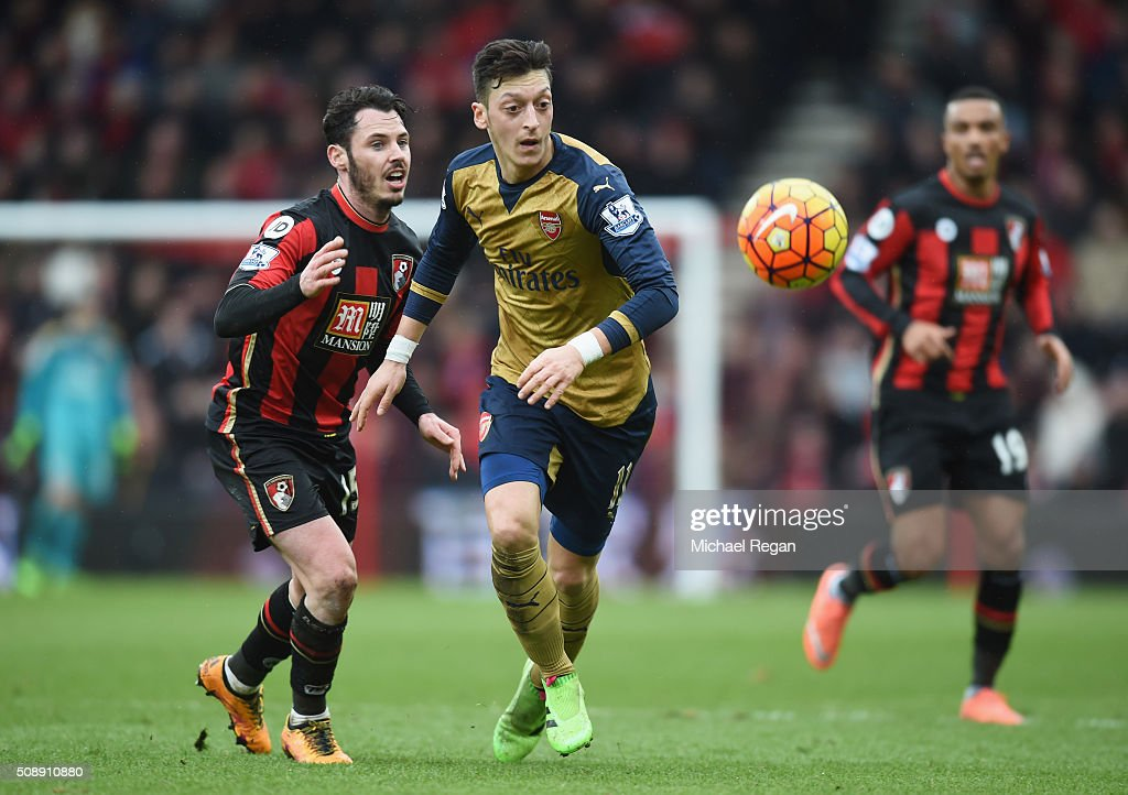 Mesut Oezil of Arsenal evades Adam Smith of Bournemouth during the Barclays Premier League match between A.F.C. Bournemouth and Arsenal at the Vitality Stadium on February 7, 2016 in Bournemouth, England.