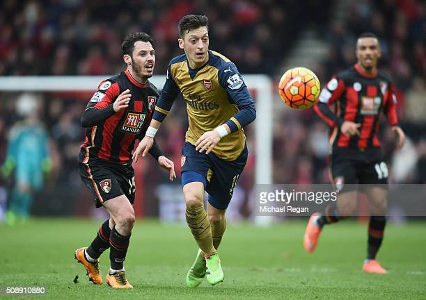 Mesut Oezil of Arsenal evades Adam Smith of Bournemouth during the Barclays Premier League match between AFC Bournemouth and Arsenal at the Vitality...