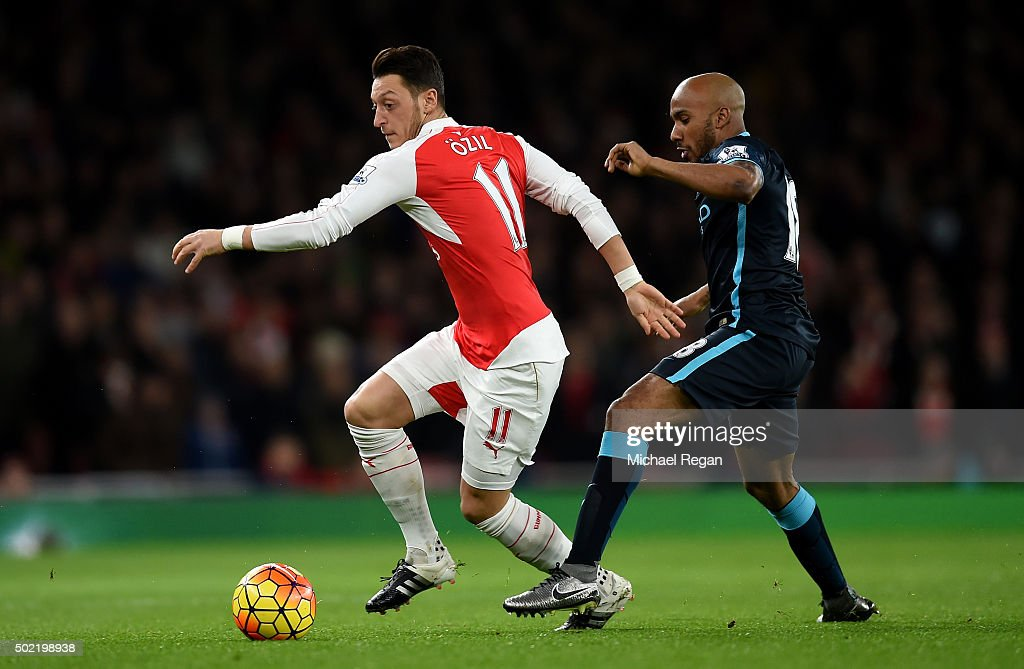 Mesut Oezil of Arsenal (L) holds off <a gi-track='captionPersonalityLinkClicked' href=/galleries/search?phrase=Fabian+Delph&family=editorial&specificpeople=5443479 ng-click='$event.stopPropagation()'>Fabian Delph</a> of Manchester City during the Barclays Premier League match between Arsenal and Manchester City at Emirates Stadium on December 21, 2015 in London, England.