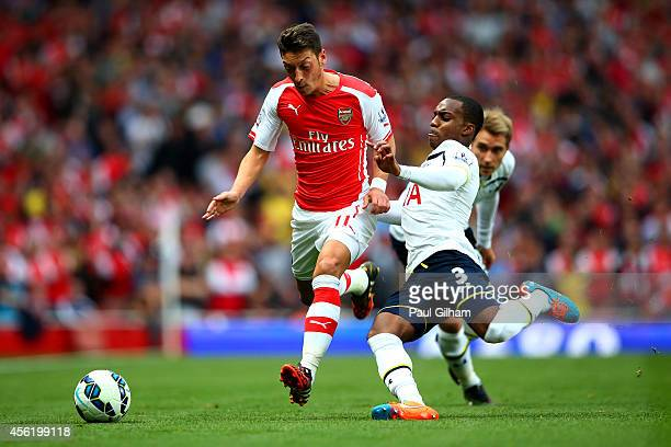 Mesut Oezil of Arsenal in action against Danny Rose of Spurs during the Barclays Premier League match between Arsenal and Tottenham Hotspur at...