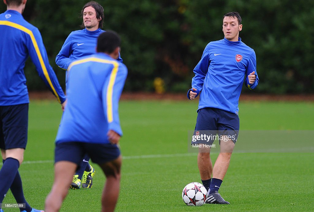 <a gi-track='captionPersonalityLinkClicked' href=/galleries/search?phrase=Mesut+Oezil&family=editorial&specificpeople=764075 ng-click='$event.stopPropagation()'>Mesut Oezil</a> of Arsenal in action during an Arsenal training session ahead of the UEFA Champions League Group F match against Borussia Dortmund at London Colney on October 21, 2013 in St Albans, England.