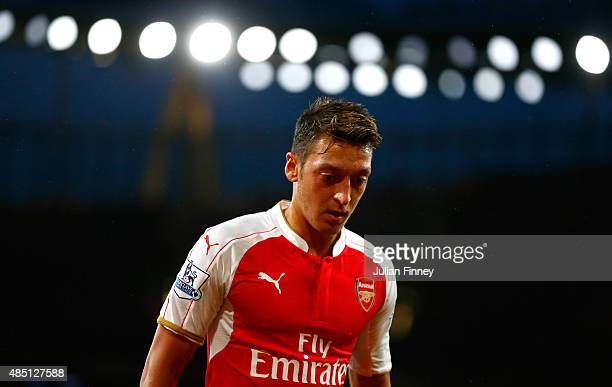 Mesut Oezil of Arsenal looks on during the Barclays Premier League match between Arsenal and Liverpool at the Emirates Stadium on August 24 2015 in...