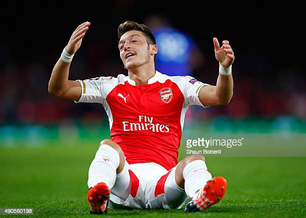 Mesut Oezil of Arsenal reacts during the UEFA Champions League Group F match between Arsenal FC and Olympiacos FC at the Emirates Stadium on...