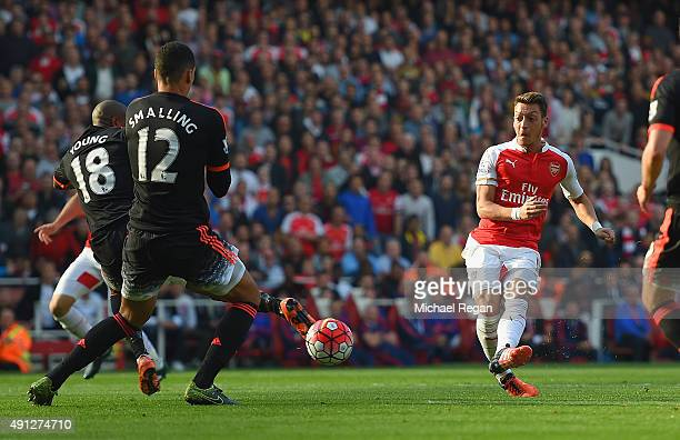 Mesut Oezil of Arsenal scores Arsenal 2nd goal during the Barclays Premier League match between Arsenal and Manchester United at Emirates Stadium on...