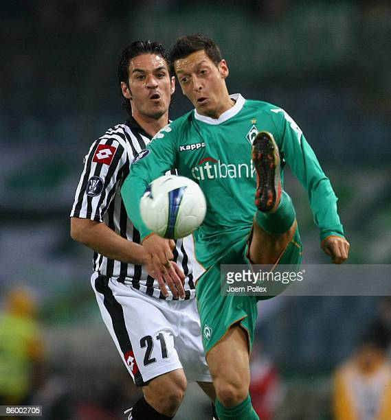 Mesut Oezil of Bremen and Gaetano D'Agostino of Udinese battle for the ball during the UEFA Cup quarter final second leg match between Udinese Calcio...