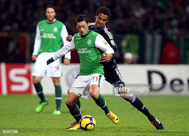 Mesut Oezil of Bremen and Joel Matip of Schalke compete for the ball during the Bundesliga match between Werder Bremen and FC Schalke 04 at the Weser...