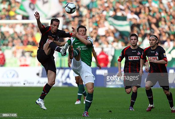 Mesut Oezil of Bremen and Petit of Koeln compete for the ball during the Bundesliga match between Werder Bremen and 1 FC Koeln at Weser Stadium on...