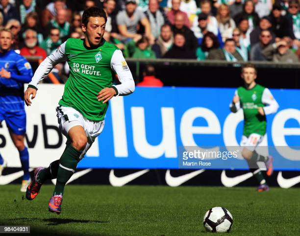 Mesut Oezil of Bremen and runs with the ball during the Bundesliga match between Werder Bremen and SC Freiburg at the Weser Stadium on April 10 2010...