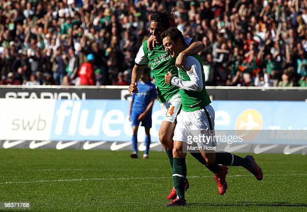 Mesut Oezil of Bremen celebrates after he scores his team's 4th goal during the Bundesliga match between Werder Bremen and SC Freiburg at the Weser...
