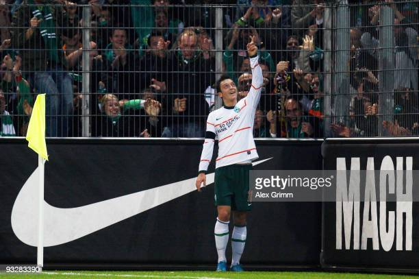 Mesut Oezil of Bremen celebrates his team's fourth goal during the Bundesliga match between SC Freiburg and Werder Bremen at the Badenova stadium on...