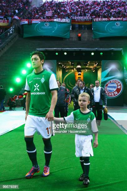 Mesut Oezil of Bremen enters the pitch prior to the DFB Cup final match between SV Werder Bremen and FC Bayern Muenchen at Olympic Stadium on May 15...